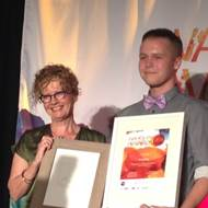 Commissioner Jenni Perkins with James Clarke winner of the 2014 Youth Awards.JPG