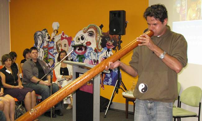 Olamn Walley playing didgeridoo for the welcome to country