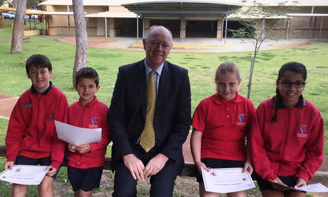 Commissioner Colin Pettit with Carine Primary School students who trialled the survey and gave feedback.