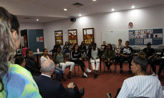 The Commissioner speaking with the young people