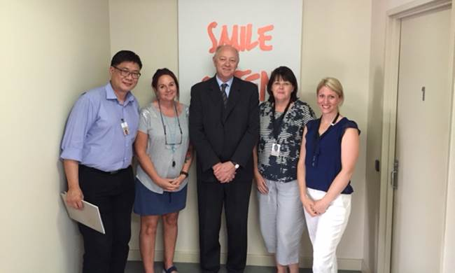 The Commissioner, Colin Pettit, with staff from the Rise Network
