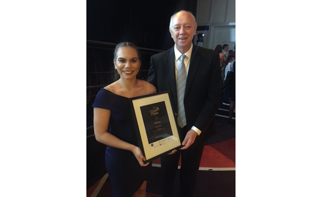 Brianne Yarran, recipient of the 2016 Participate Award, with the Commissioner Colin Pettit
