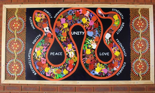 The mural mounted on the school grounds