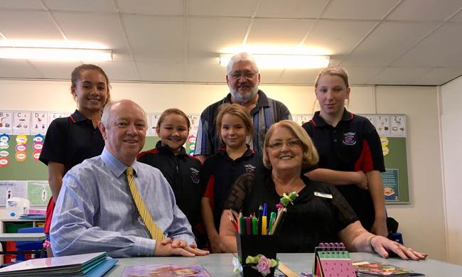 Commissioner Colin Pettit with principal and students at Laverton School