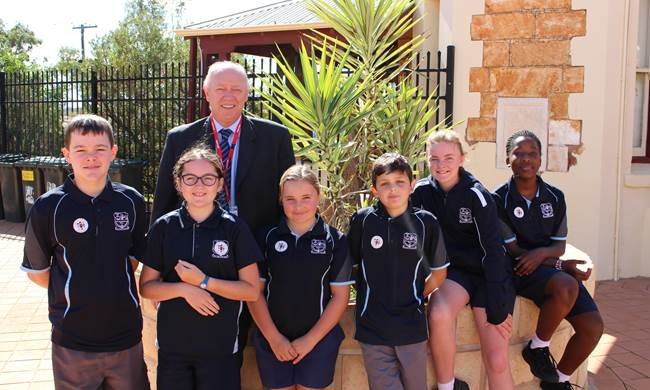 Commissioner Colin Pettit with students from Our Lady of Mount Carmel Primary School