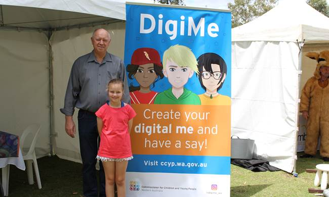 Commissioner Colin Pettit with Michaela, helping to create her DigiMe