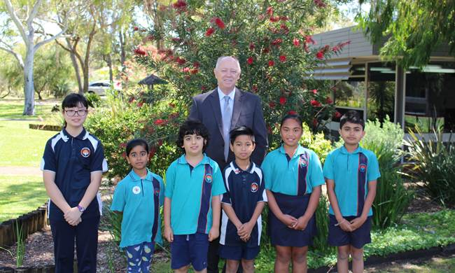 Commissioner Colin Pettit with students from Warrapiendi Primary School