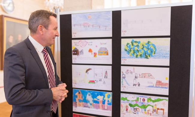 Premier Mark McGowan MLA viewing the We Are 10 exhibition at Parliament House